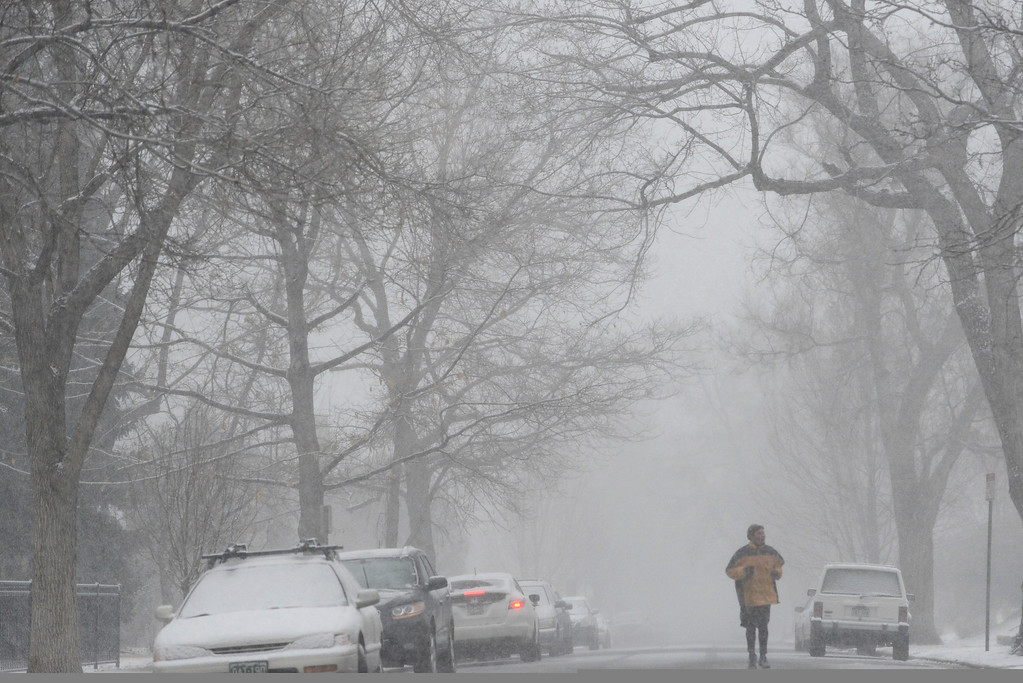 . DENVER, CO - FEBRUARY 20: Paul Jacbos jogs on Elizabeth as snow falls. Snow is expected through Thrusday. (Photo by AAron Ontiveroz/The Denver Post)