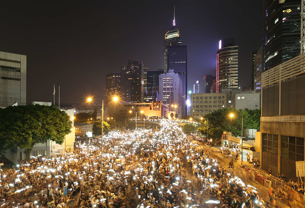 . In this long exposure photo, pro-democracy demonstrators hold up their mobile phones during a protest near the Hong Kong government headquarters on September 29, 2014. AFP PHOTO /AARON  tam/AFP/Getty Images