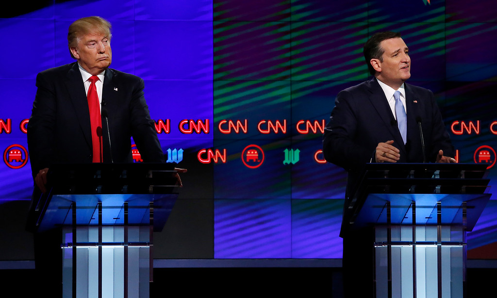 ". File - Donald Trump (L) listens to Texas Senator Ted Cruz (R) speak during the CNN Republican Presidential Debate March 10, 2016 in Miami, Florida. Cruz announced Friday, Sept. 23, 2016, he will vote for Donald Trump, a dramatic about-face for the Texas senator who previously called the New York businessman a ""pathological liar\"" and \""utterly amoral.\"" (RHONA WISE/AFP/Getty Images)"