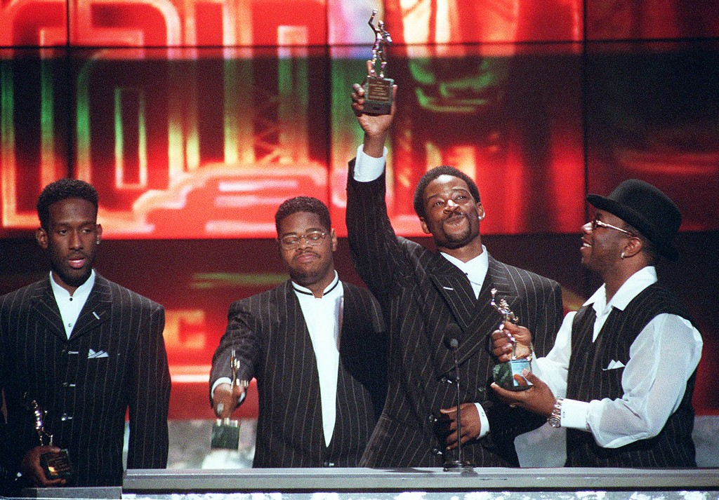 . Members of the group Boyz II Men, from left, Shawn Stockman, Michael McCary, Nate Morris and Wanya Morris accept the Sammy Davis Jr. award for Entertainers of the Year at the Soul Train Awards at the Shrine Auditorium in Los Angeles, Friday, March 29, 1996. (AP Photo/Mark J. Terrill) <%% 0 PICTURE_OK HEADER_OK 0 2 %%>