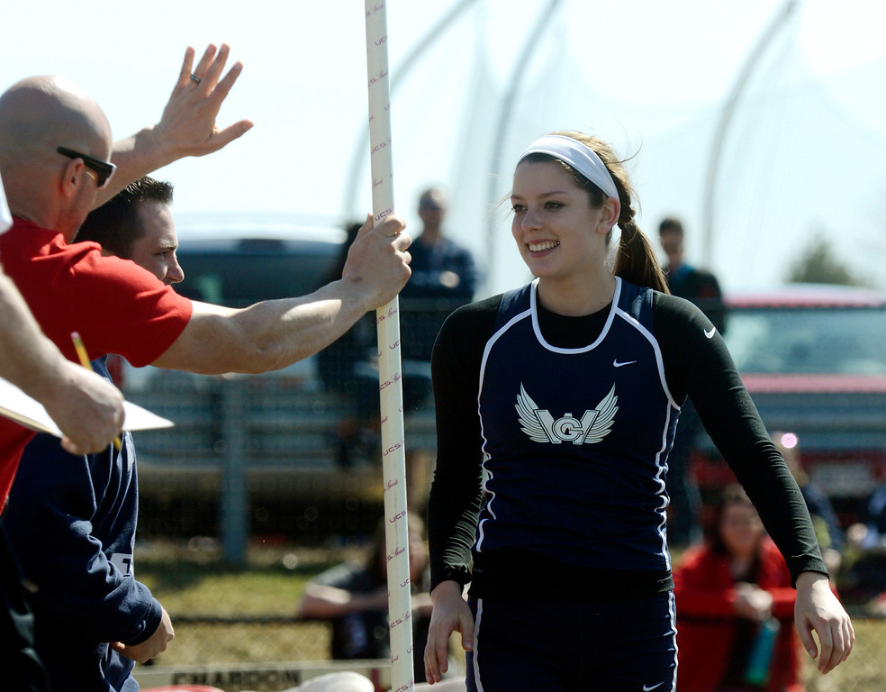 . Maribeth Joeright/MJoeright@News-Herald.com<p> West Geauga\'s Audrey Rabe is congratulated by Geneva coach Bobby McQuoyb after Rabe set a meet and area record in the girls pole vault during the Hilltopper Invitational track meet at Chardon High School, April 12, 2014.