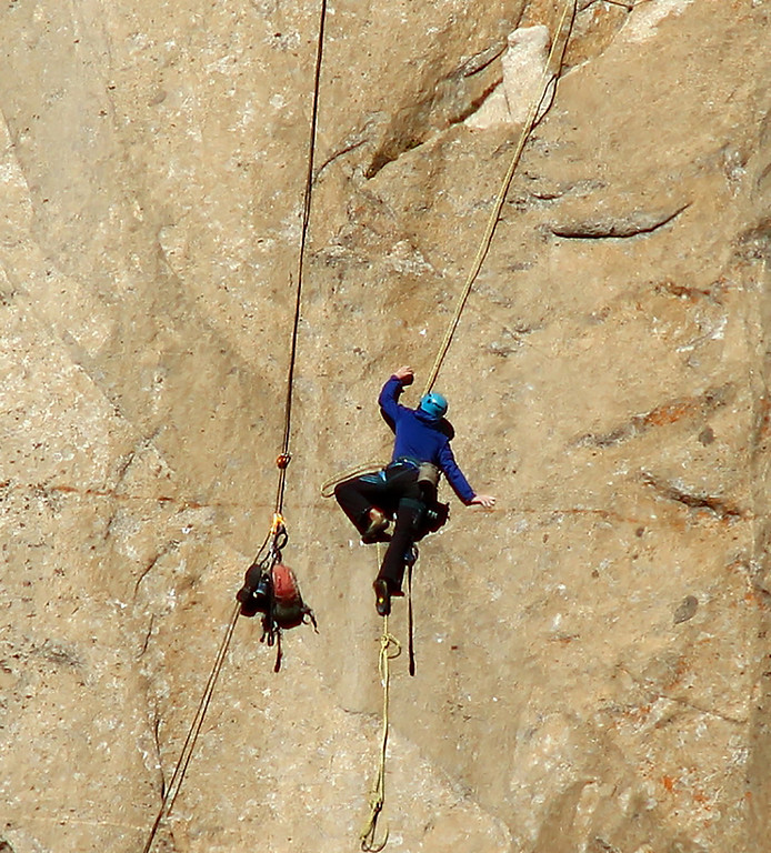 . In this Dec. 28, 2014 photo provided by Tom Evans, Kevin Jorgeson ascends what is known as Pitch 8 as two men attempt what has been called the hardest rock climb in the world: a free climb of a El Capitan, the largest monolith of granite in the world, a half-mile section of exposed granite in California\'s Yosemite National Park. (AP Photo/Tom Evans, elcapreport)