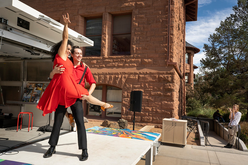 Previous Cultural Program Coordinator Ana Gabriela Pareja Alfaro and senior Manuel Uribe dance with the CC Mobile Arts Open Mic program during Homecoming and Family Weekend Picnic/Lawn Games on Saturday, October 9, 2021. Photo by Lonnie Timmons III / Colorado College.  10/9/21