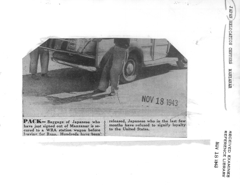 """""""Pack -- Baggage of Japanese who have just signed out of Manzanar is secured to a WRA station wagon before leaving for Reno"""" -- caption on photograph"""