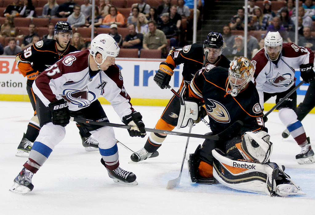 . Anaheim Ducks goalie Frederik Andersen, right,  blocks against Colorado Avalanche left wing Cody McLeod during the first period of an NHL hockey preseason game in Anaheim, Calif., Monday, Sept. 22, 2014. (AP Photo/Chris Carlson)