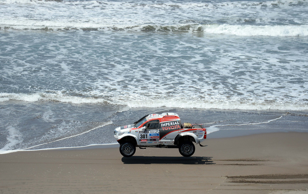 . Toyota\'s driver Giniel De Villiers of South Africa competes during Stage 4 of the Dakar 2013 between Nazca and Arequipa, Peru, on January 8, 2013. The rally will take place in Peru, Argentina and Chile from January 5 to 20. FRANCK FIFE/AFP/Getty Images