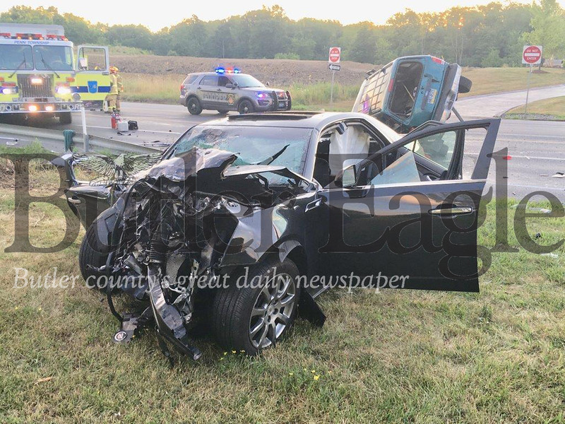 State police and volunteer firefighters respond to two-vehicle crash on Route 8 in Penn Township that left both drivers seriously injured.