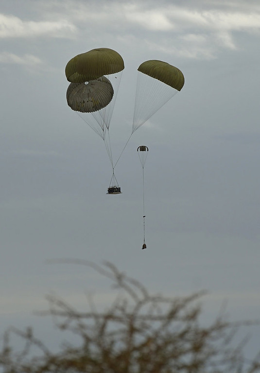 . French army drop a jeep with parachutes at the Timbuktu airport on January 28, 2013. Hundreds of people gave French-led troops a hero\'s welcome on Monday as they entered the historic city of Timbuktu, occupied for 10 months by Islamists who imposed a harsh form of sharia.  ERIC FEFERBERG/AFP/Getty Images