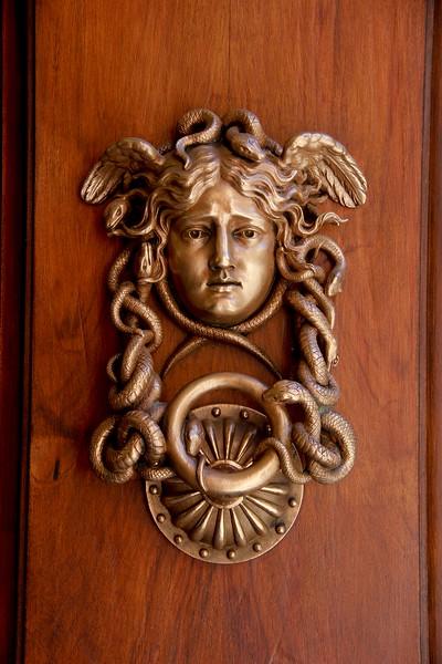 Door knocker on the Italian Ministry of Defense building, Rome.