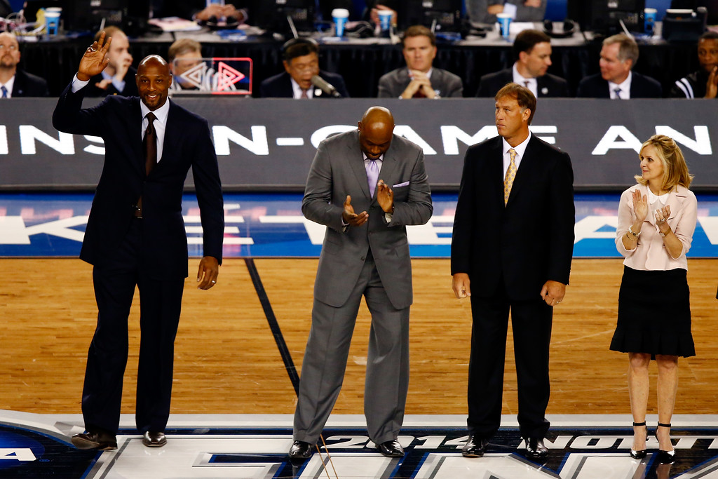 . ARLINGTON, TX - APRIL 07:  Naismith Memorial Basketball Hall of Fame inductee Alonzo Mourning acknowledges the crowd during the NCAA Men\'s Final Four Championship between the Kentucky Wildcats and the Connecticut Huskies at AT&T Stadium on April 7, 2014 in Arlington, Texas.  (Photo by Tom Pennington/Getty Images)