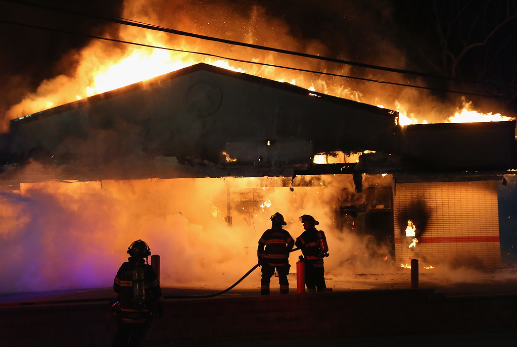 . A restaurant burns after it was set on fire when protestors rioted following the grand jury announcement in the Michael Brown case on November 24, 2014 in Ferguson, Missouri. Ferguson has been struggling to return to normal after Brown, an 18-year-old black man, was killed by Darren Wilson, a white Ferguson police officer, on August 9. His death has sparked months of sometimes violent protests in Ferguson. A grand jury today declined to indict officer Wilson.  (Photo by Scott Olson/Getty Images)