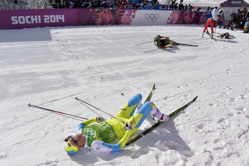 . Slovenia\'s Katja Visnar lies on the snow after crossing the finish line in the Women\'s Cross-Country Skiing Team Sprint Classic Semifinals at the Laura Cross-Country Ski and Biathlon Center during the Sochi Winter Olympics on February 19, 2014 in Rosa Khutor near Sochi. (ODD ANDERSEN/AFP/Getty Images)
