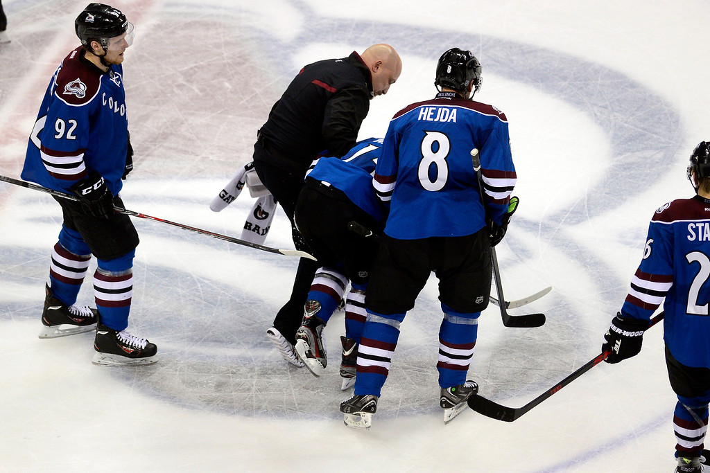 . P.A. Parenteau of the Colorado Avalanche is helped off the ice after being injured during the second period against the Winnipeg Jets. (Photo by AAron Ontiveroz/The Denver Post)