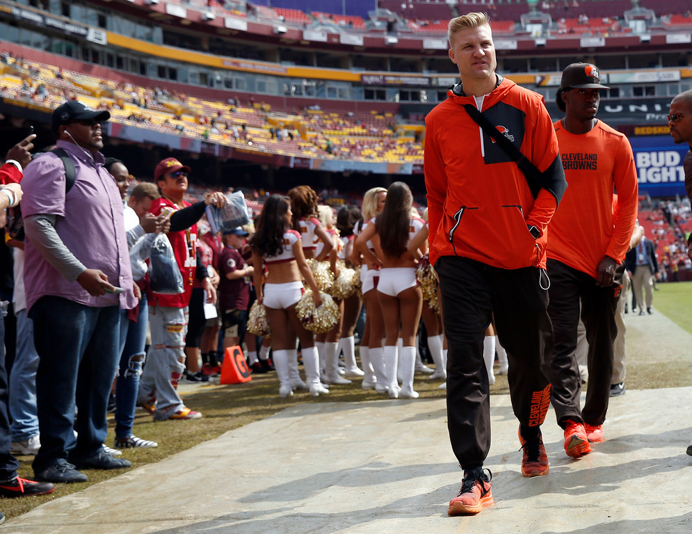 . Injured Cleveland Browns quarterbacks Josh McCown, left, and Robert Griffin III head off the field before an NFL football game against the Washington Redskins, Sunday, Oct. 2, 2016, in Landover, Md. (AP Photo/Carolyn Kaster)
