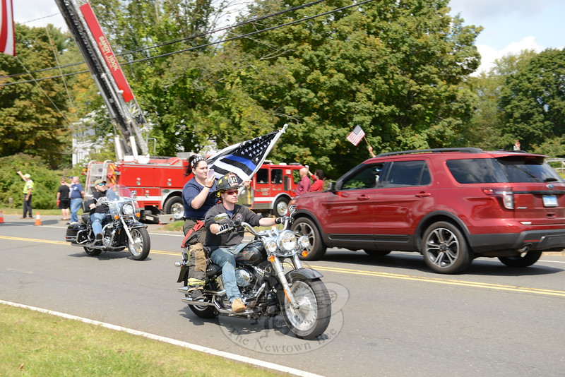 CT United Ride firefighters carrying black and blue flag