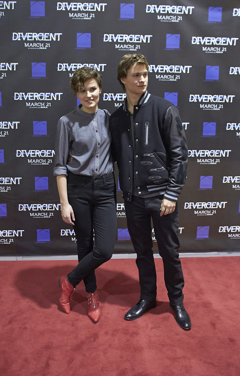 """. \""""Divergent\"""" author Veronica Roth and actor Ansel Elgort attend the \""""Divergent\"""" screening at the Mall of America on March 5, 2014 in Bloomington, Minnesota. (Photo by Adam Bettcher/Getty Images)"""