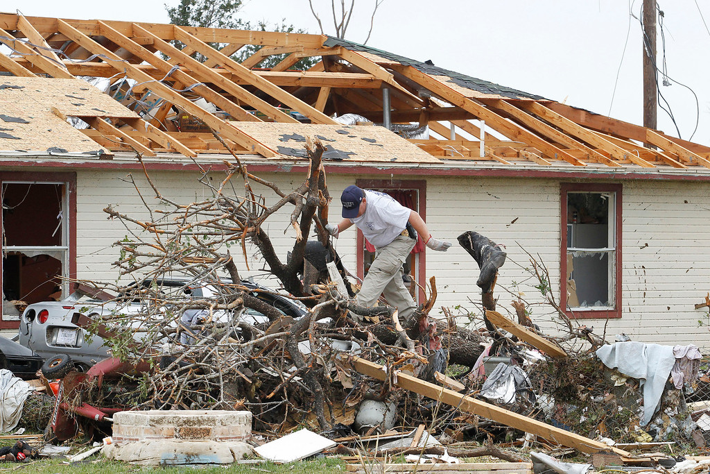 . Crushed autos sit amid the rubble of destroyed homes as emergency personnel continue search efforts  in the Rancho Brazos neighborhood in Granbury, Texas, Thursday, May 16, 2013.  (AP Photo/The Fort Worth Star-Telegram, Paul Moseley)