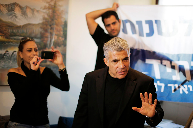 . Yair Lapid, leader of the Yesh Atid party, speaks to campaign volunteers in the southern city of Ashkelon ahead of Tuesday\'s parliamentary election January 21, 2013. Formed this year by Lapid, a popular TV personality who recently turned to politics, the party is promoting secular, centrist politics and has attacked Israeli Prime Minister Benjamin Netanyahu over rising power, water, petrol and housing prices. REUTERS/Amir Cohen