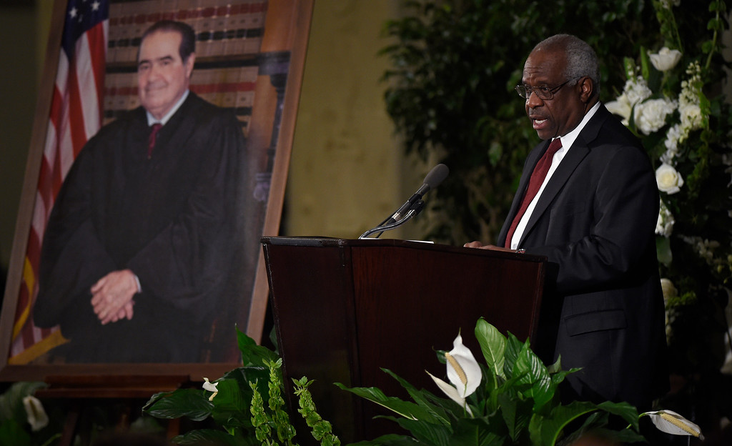 . Supreme Court Justice Clarence Thomas speaks at the memorial service for Supreme Court Justice Antonin Scalia, Tuesday, March 1, 2016, at the Mayflower Hotel in Washington. (AP Photo/Susan Walsh, Pool)