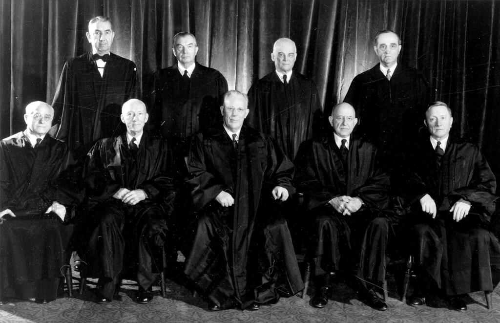 . Members of the U.S. Supreme Court are seen in a 1953 photo before they issued the first school integration order in 1954.  From Left, seated Associated Justices Felix Frankfurter and Hugo Black, Chief Justice Earl Warren, and Associate Justices Stanley Reed and William O\'Douglas.  Standing:  Associate Justices Tom Clark, Robert H. Jackson, Harold H. Burton and Sherman Minton.  (AP Photo)