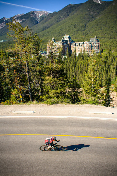 Cyclist passing by the Fairmont Banff Springs near the town of Banff, Alberta.