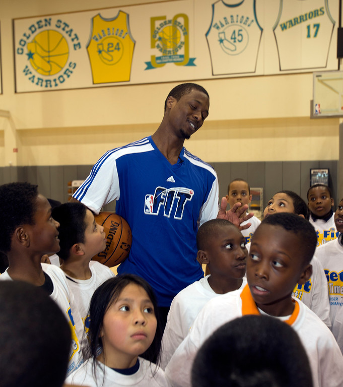 . Golden State Warriors forward Harrison Barnes, top, shares a laugh with a group of children participating in a basketball clinic at the Warriors practice facility in downtown Oakland, Calif., Wednesday, Jan. 30, 2013. The Warriors and Kaiser Permanente hosted the event as part of the NBA FIT Live Healthy Week. (D. Ross Cameron/Staff)