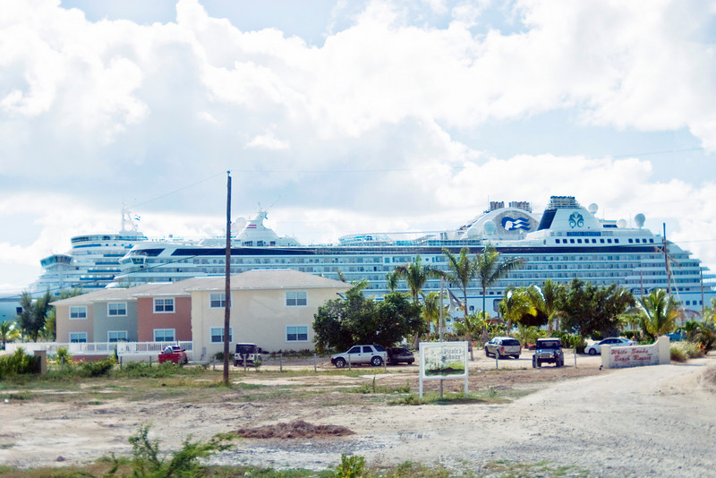 Local housing for Grand Turk residents with the cruise ships behind them