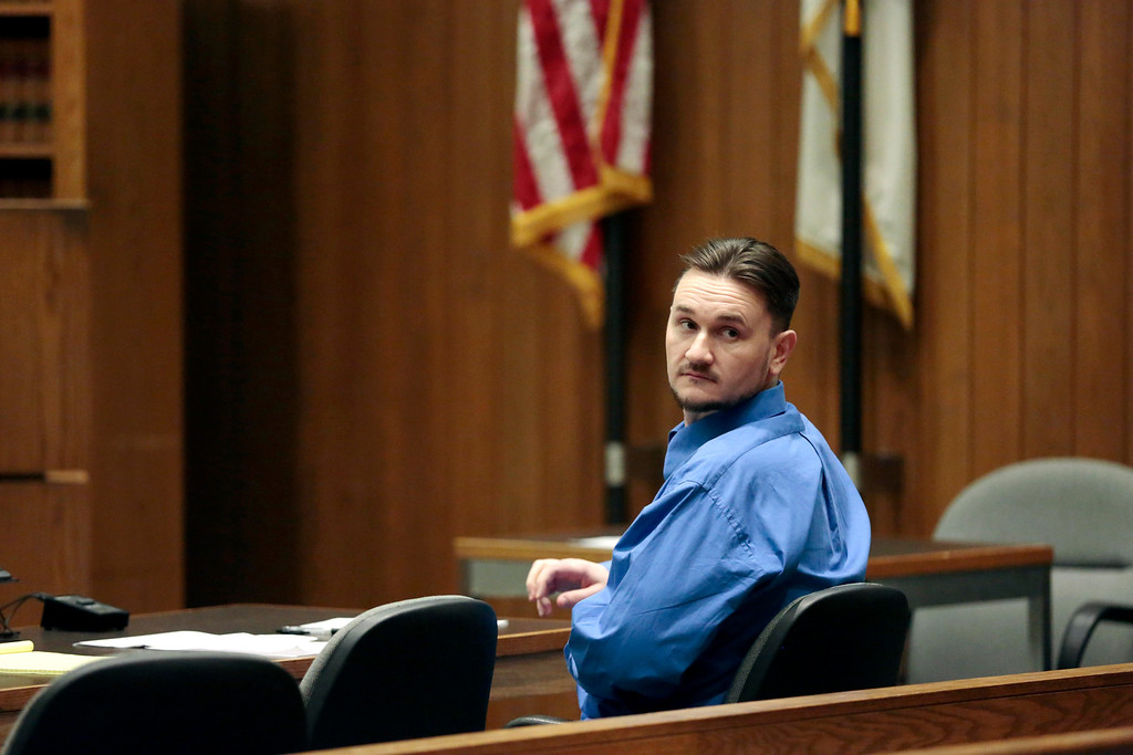 . Adam Lee Hall waits for court to be back in session during the first day of his triple murder trial at the Springfield Courthouse. Monday, January 13, 2014. (AP Photo/Stephanie Zollshan, The Berkshire Eagle)