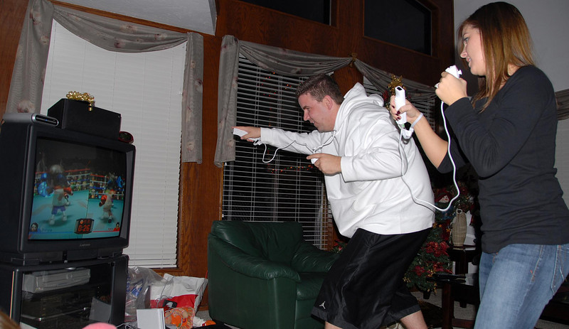 11/30/07 – The family gathered at my parent's home for dinner. My sister Danna brought a Wii game console she recently bought. We had a blast bowling, golfing, playing tennis, or as you can see Jen and Gary  boxing. It is so physical we were tired and sore when we were done.