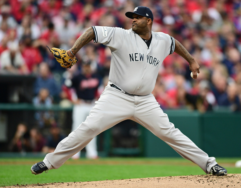 . New York Yankees starting pitcher CC Sabathia delivers in the first inning of Game 2 of baseball\'s American League Division Series against the Cleveland Indians, Friday, Oct. 6, 2017, in Cleveland. (AP Photo/David Dermer)