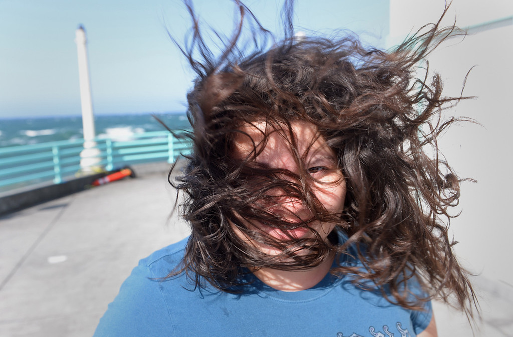 . Yvette Martinez of Hawthorne came out to the Manhattan Beach Pier to check out the wind and waves. Photo by Brad Graverson 4-8-13