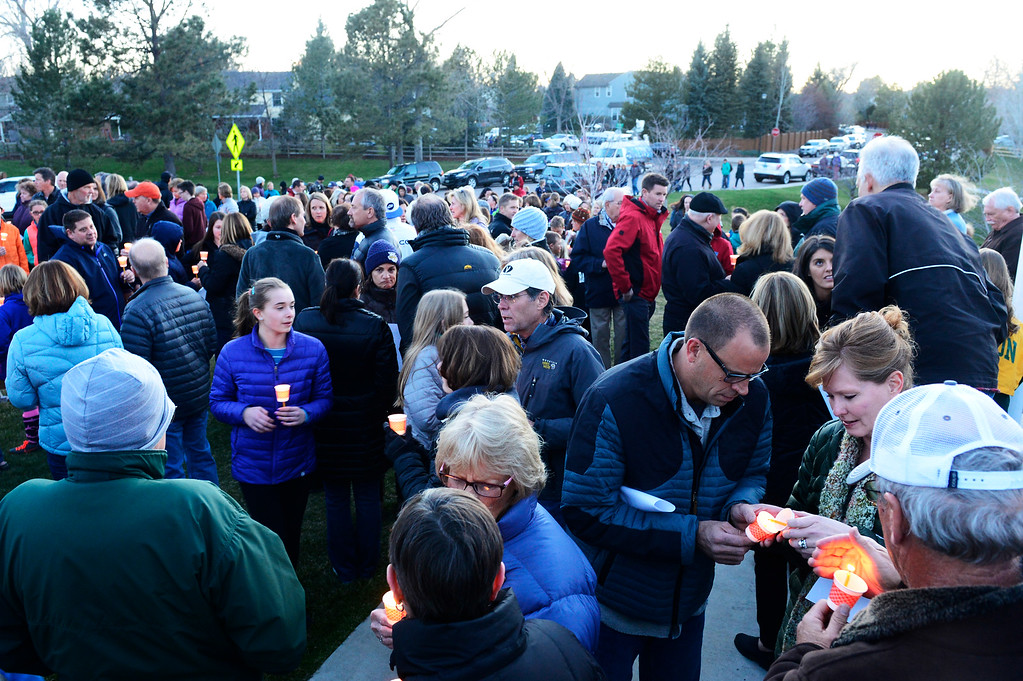 . People gather to light their candles for the start of the vigil for Dr. Kenneth Atkinson on April 5, 2016 in Centennial, Colorado. Close to 400 people showed up to pay their respects to Dr. Atkinson, who lost his life trying to protect a woman whose husband shot her. (Photo by Brent Lewis/The Denver Post)