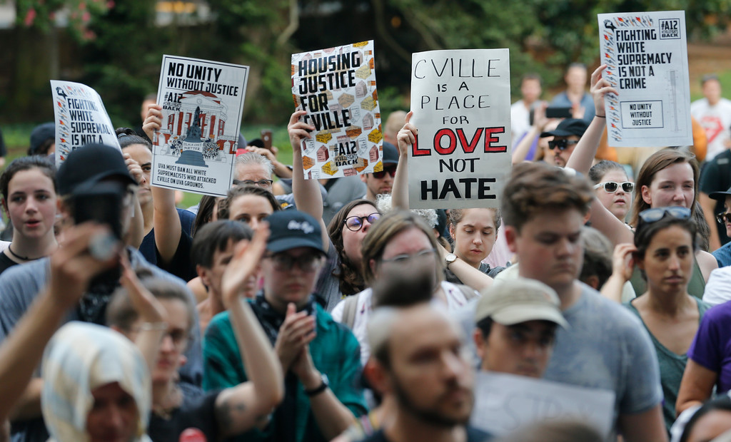 . Demonstrators march on the campus of the University of Virginia in anticipation of the anniversary of last year\'s Unite the Right rally in Charlottesville, Va., Saturday, Aug. 11, 2018. (AP Photo/Steve Helber)