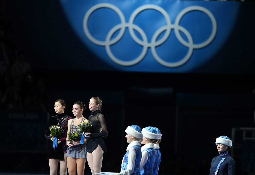 . (L-R) Silver medalist Kim Yuna of South Korea, gold medalist Adelina Sotnikova of Russia and bronze medalist Carolina Kostner of Italy during the flower ceremony after the Women\'s Free Skating Figure Skating event at Iceberg Skating Palace during the Sochi 2014 Olympic Games, Sochi, Russia, 20 February 2014.  EPA/HOW HWEE YOUNG