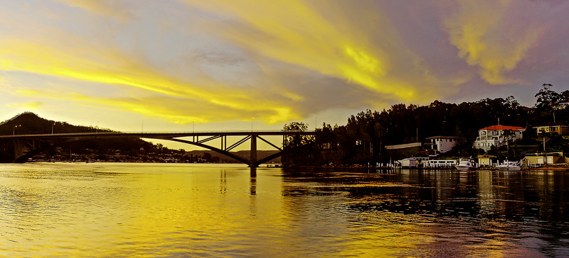 Golden colored coastal sunrise over the Rip Bridge