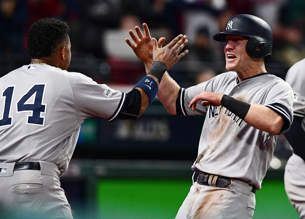 . New York Yankees\' Todd Frazier, right, celebrates with Starlin Castro after Frazier scored in the ninth inning of Game 5 of baseball\'s American League Division Series against the Cleveland Indians, Wednesday, Oct. 11, 2017, in Cleveland. (AP Photo/David Dermer)