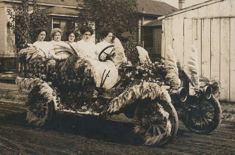 Postcard of a flower-decked car ready for a parade, ca.1915
