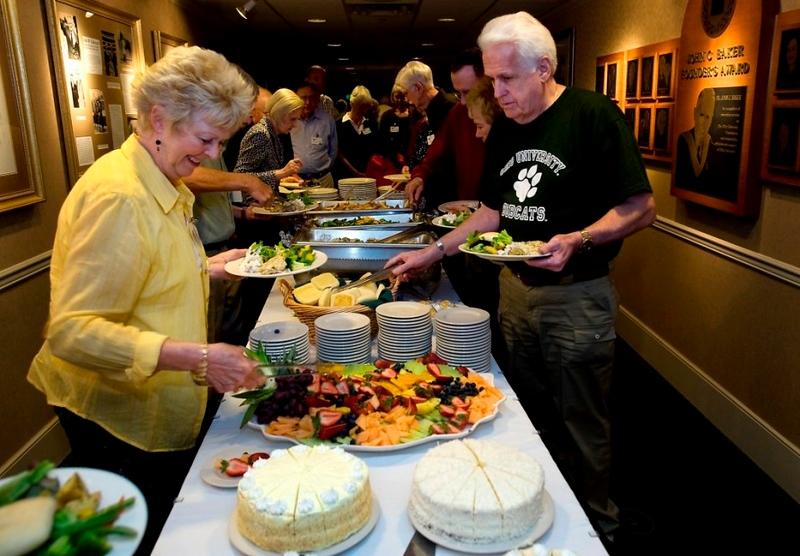 Members of the class of 59' enjoy their Golden Reunion dinner.
