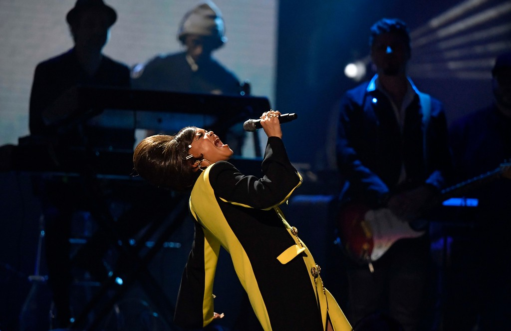 . Recording artist Andra Day pays tribute to Nina Simone during the Rock and Roll Hall of Fame induction ceremony, Saturday, April 14, 2018, in Cleveland. (AP Photo/David Richard)