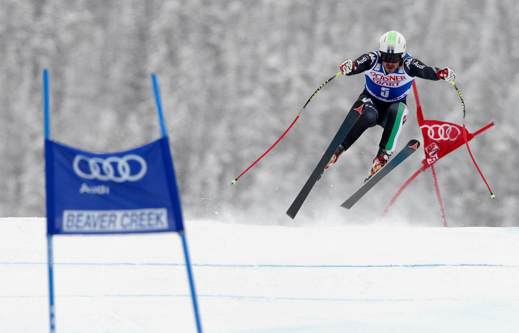 . Italy\'s Peter Fill flies off the Red Tail jump during the men\'s World Cup super-G skiing event, Saturday, Dec. 7, 2013, in Beaver Creek, Colo. Fill finished tied for third place with Austria\'s Hannes Reichelt. Switzerland\'s Patrick Kueng won the race and Austria\'s Otmar Striedinger finished second. (AP Photo/ Charles Krupa)