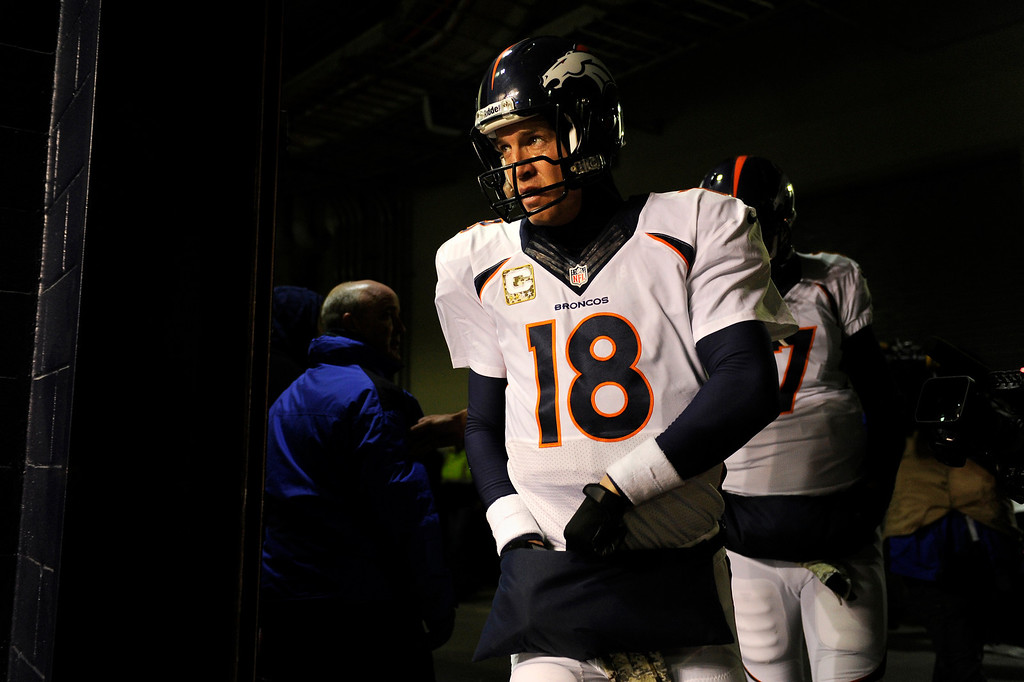 . Quarterback Peyton Manning #18 of the Denver Broncos heads to the field for their game against  the New England Patriots at Gillette Stadium in Foxborough Mass., on November 24, 2013. (Photo By Joe Amon/The Denver Post)