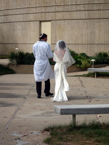 Avram and Abby leave together for Yichud, during which they meet privately for the first time as husband and wife