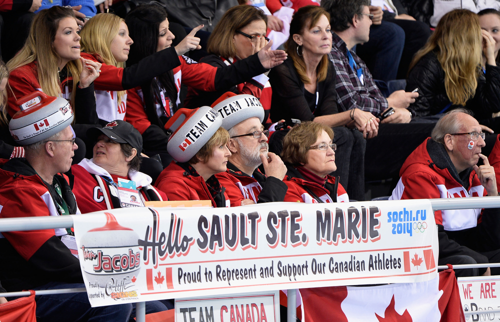 . Canada fans show their support during the Men\'s Gold Medal match between Canada and Great Britain on day 14 of the Sochi 2014 Winter Olympics at Ice Cube Curling Center on February 21, 2014 in Sochi, Russia.  (Photo by Pascal Le Segretain/Getty Images)
