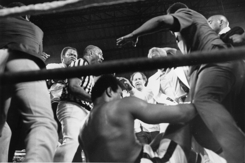 . An exhausted Muhammad Ali falls to the canvas after knocking out defending champion George Forman and regaining the world heavyweight title in Kinshasa, Zaire, Oct. 30, 1974.  Ali knocked out Foreman in the eighth to regain the world heavyweight title.  (AP Photo)