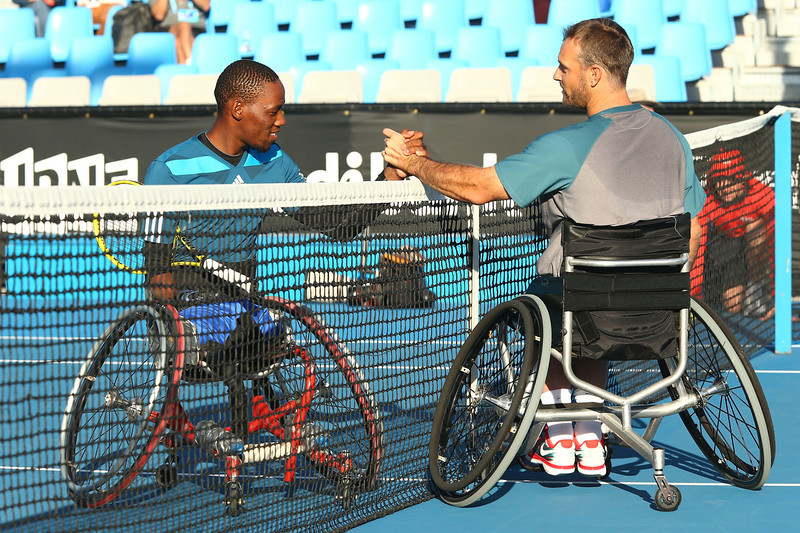 . David Wagner of the United States shakes hands with  Lucas Sitole of South Africa after Wagner won their Quad Wheelchair Singles Final during the 2014 Australian Open Wheelchair Championships at Melbourne Park on January 25, 2014 in Melbourne, Australia.  (Photo by Robert Prezioso/Getty Images)
