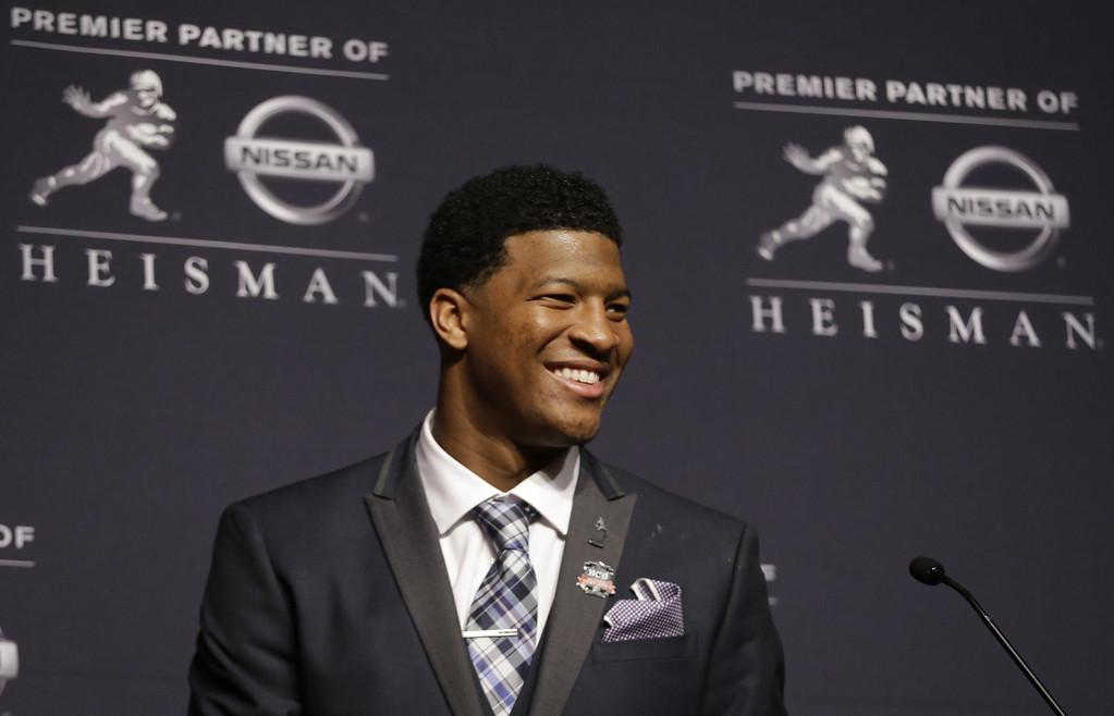 . Florida State quarterback Jameis Winston talks to reporters after winning the Heisman Trophy, Saturday, Dec. 14, 2013, in New York. (AP Photo/Julio Cortez)