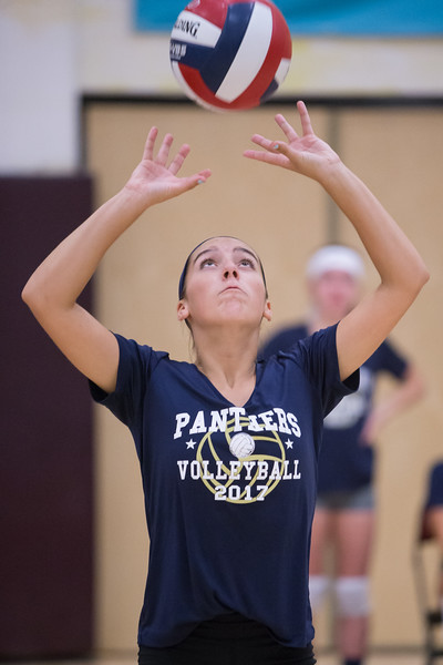 Platt's Caitlyn Hart sets for Vanessa Ixyk Tuesday during a jamboree at New Britian High School in New Britian Sep. 5, 2017 | Justin Weekes / For the Record-Journal