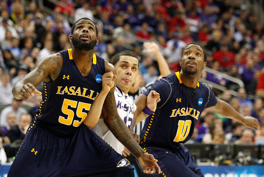. KANSAS CITY, MO - MARCH 22:  Ramon Galloway #55 and Sam Mills #10 of the La Salle Explorers box out against Angel Rodriguez #13 of the Kansas State Wildcats in the first half during the second round of the 2013 NCAA Men\'s Basketball Tournament at the Sprint Center on March 22, 2013 in Kansas City, Missouri.  (Photo by Ed Zurga/Getty Images)