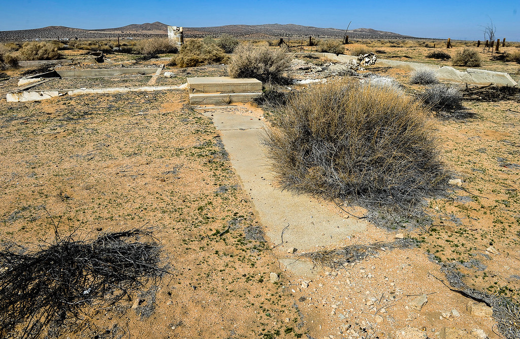 . Foundation is all that is left of a home in Hinkley, Calif. on Saturday, March 16, 2013. In the last two years, residents have become aware that a toxic water plume continues to grow below their small town, some have moved out of Hinkley. (Rachel Luna / San Bernardino Sun)