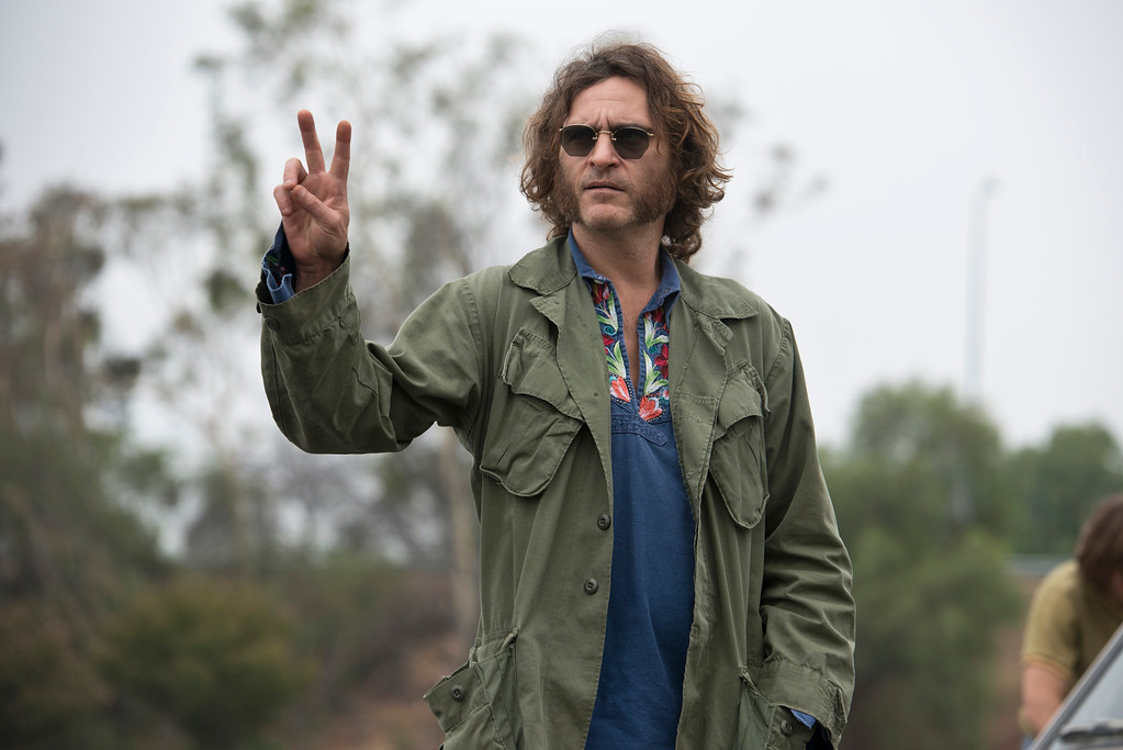 """. This photo provided by Warner Bros. Pictures shows Joaquin Phoenix as Larry \""""Doc\"""" Sportello in \""""Inherent Vice.\"""" Phoenix was nominated for a Golden Globe for best actor in a comedy or musical for his role in the film on Thursday, Dec. 11, 2014. The 72nd annual Golden Globe awards will air on NBC on Sunday, Jan. 11. (AP Photo/Warner Bros. Pictures, Wilson Webb)"""